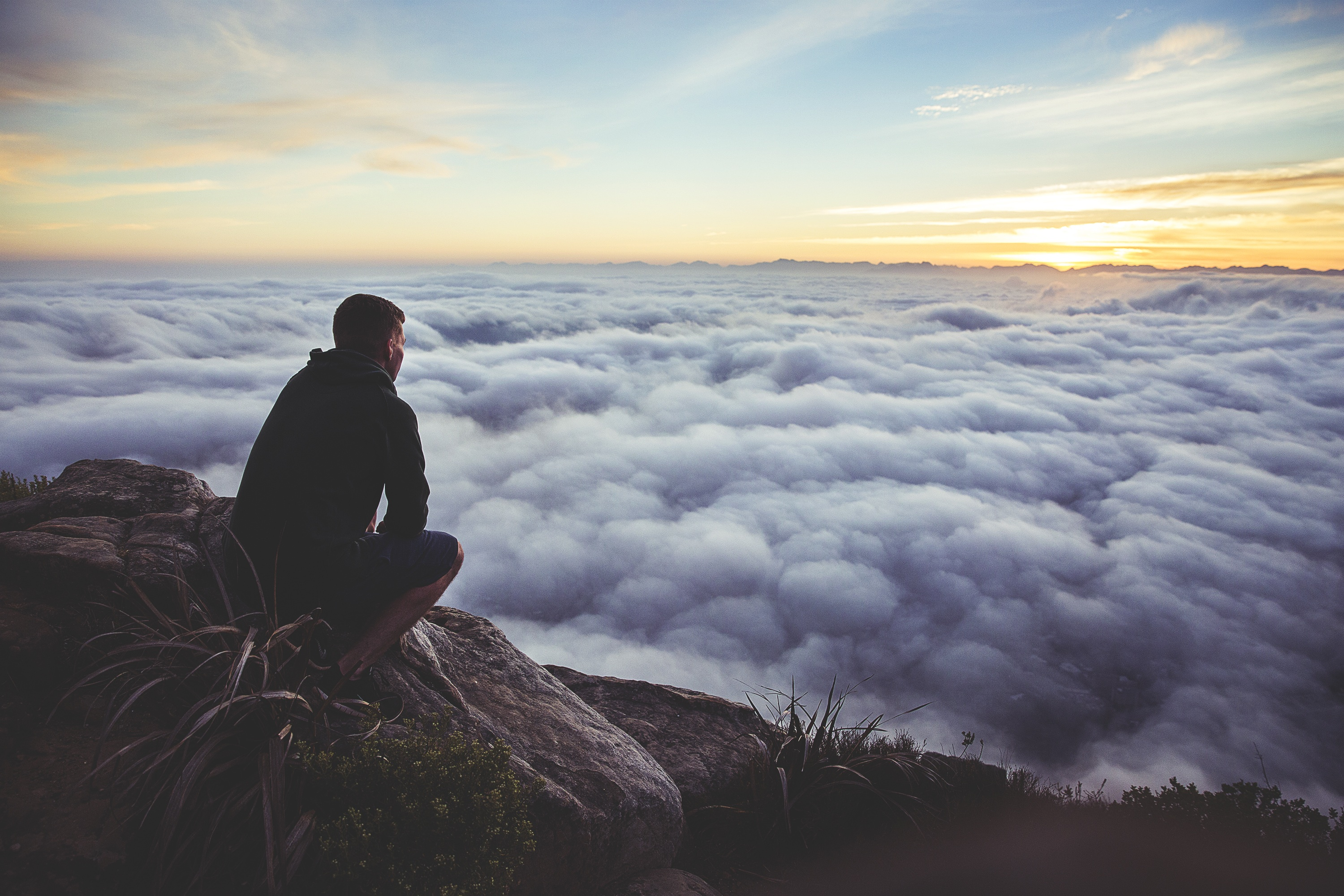 man-overlooking-clouds-from-unsplash-by-joshua-earle