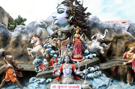Shiva at the top of the churning of the milky ocean, swallowing the poison (photo copyright elishams 2006)