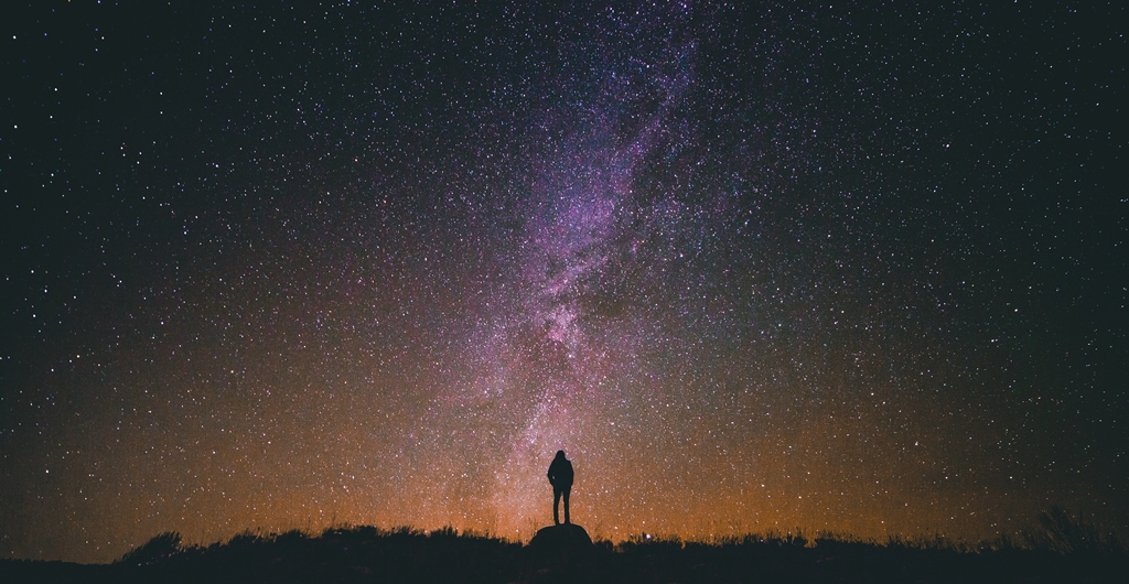 woman-looking-at-stars-galaxy-from-unsplash-by-greg-rakozy_resize