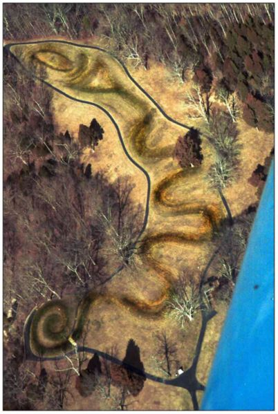 The serpent mound in Ohio, whose head aligns with the summer solstice sunset. (photo copyright 2002 Timothy A. Price and Nicole I.)