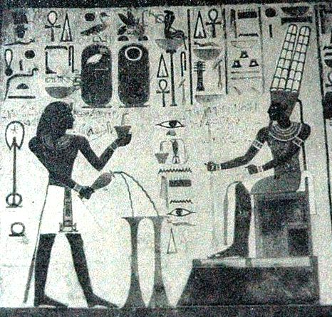The creator god Amun being worshiped, seated with his feet raised above the level of the ground.