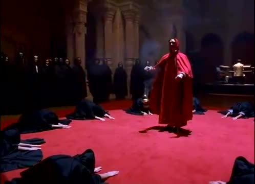 A scene from Stanley Kubrick's Movie Eyes Wide Shut depicting a ceremony of a secret society of the elite