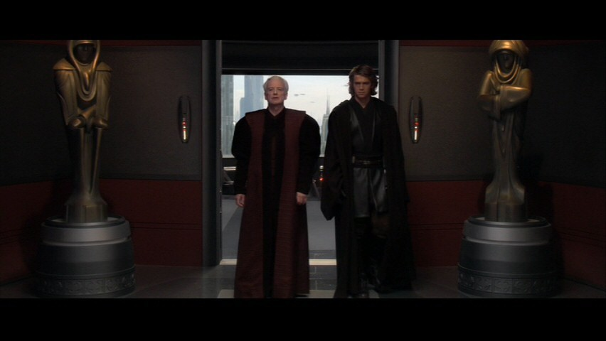 "To the left is the Sith lord Sidious who turns the Jedi on the right to the ""dark side"". Notice the statues in the background both have their left arms over their right. This is used by demons (instead it is right over left for those of the light). It signifies the ""left-handed path""."