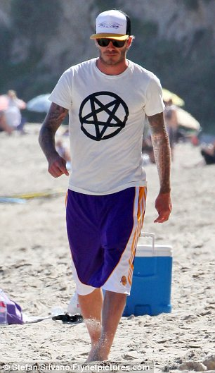 Hero of a nation, trendsetter and idol of millions of boys – David Beckham sports an upside down pentagram, symbol of the descent of man/woman into the abyss. Image source: http://www.dailymail.co.uk/tvshowbiz/article-1377805/David-Beckham-beach-day-boys-Malibu.html